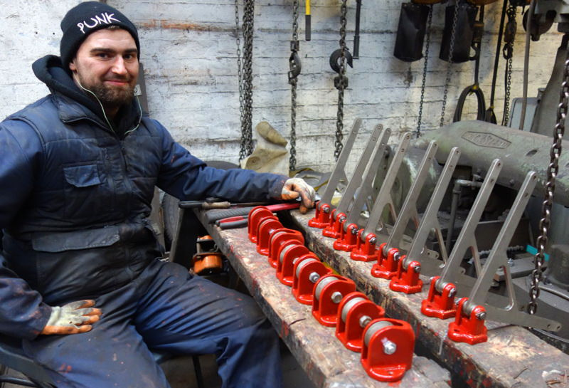 Will prepares the restored pulleys and quadrants for dispatch.