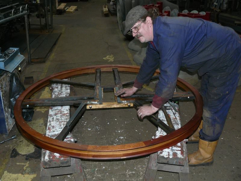 Damaged bell wheel being restored with new outer soling and shrouding.