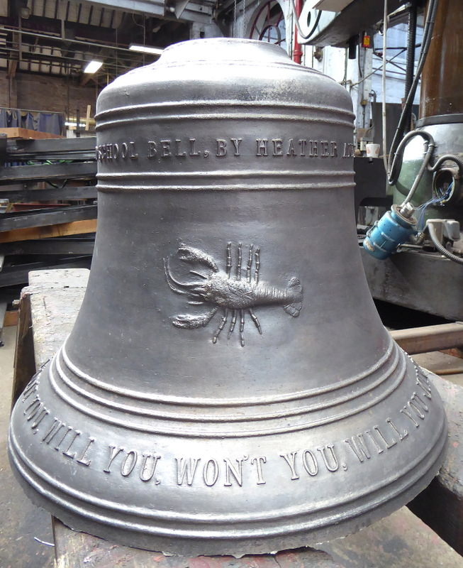 The newly cast bell, with school logo, straight from the Foundry before final fettling.