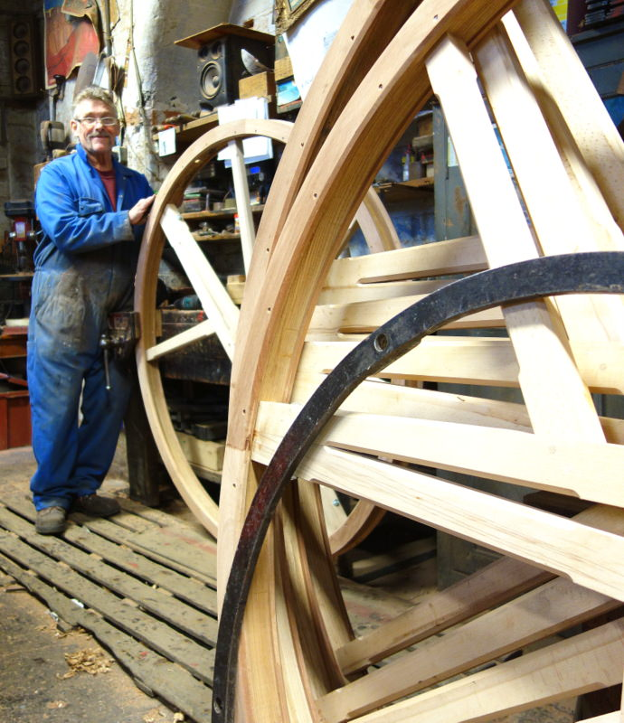 Mick works on the new set of ten bell wheels - made from furniture grade seasoned hardwood they'll certainly last more than a century.