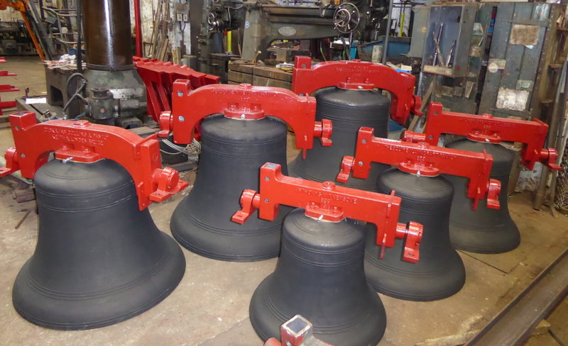 The bells lined up ready for final polish and dispatch.
