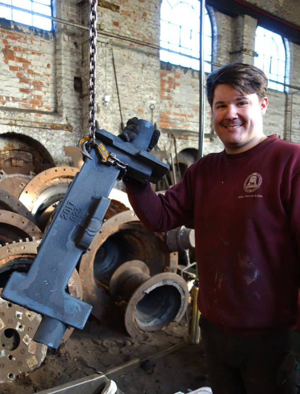 Anthony cleans the first of Cretingham's new headstocks straight from its mould.