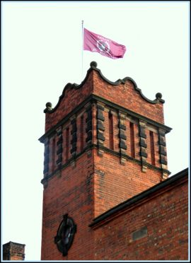 The John Taylor Bell Foundry flag atop the bell tower.
