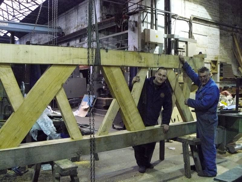 Constructing a replacement frame side in oak copying an existing ancient frame both as part of a restoration and also to allow augmentation.