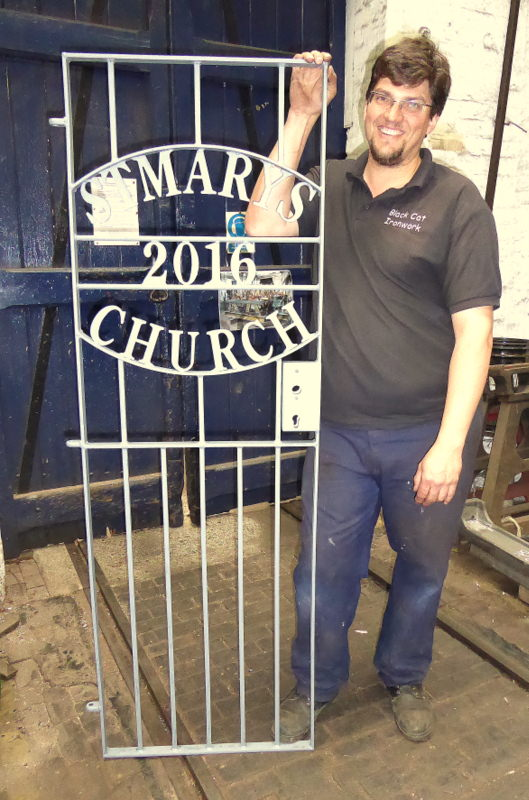 Also part of the contract - Carl with one of three iron gates he has manufactured for the belfry stairway.