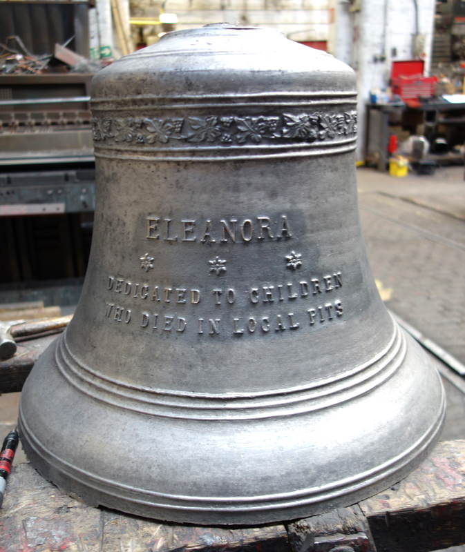 One of the new bells before fettling with a poignant inscription.