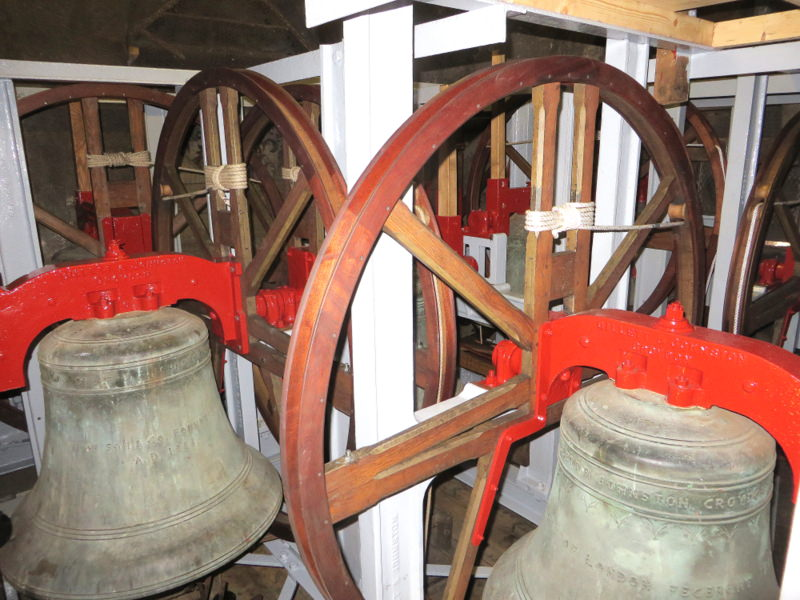 The cleaned and painted bell frame and the restored fittings.