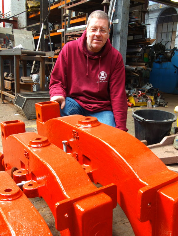 Terry Streeter with Middleham's restored headstocks.