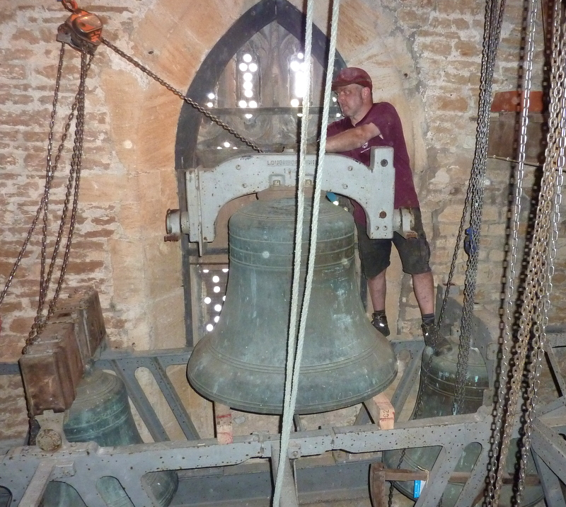 Andrew Ogden removes the tenor bell to allow access for the removal of those components returning to Loughborough