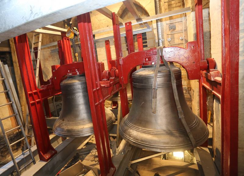 The first of the bells hanging in the new bell frame.