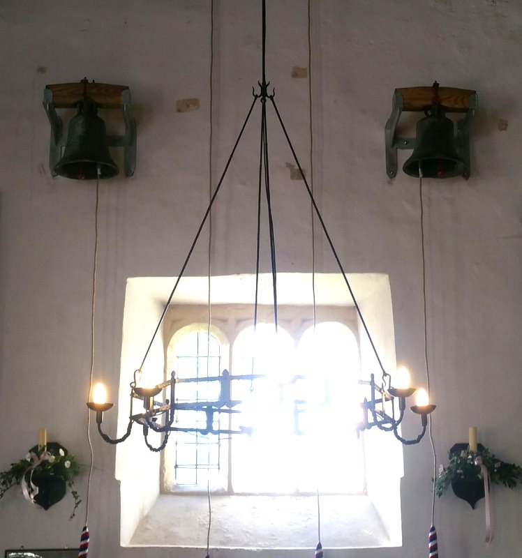 The two ancient bells now hang inside the church on the west wall.
