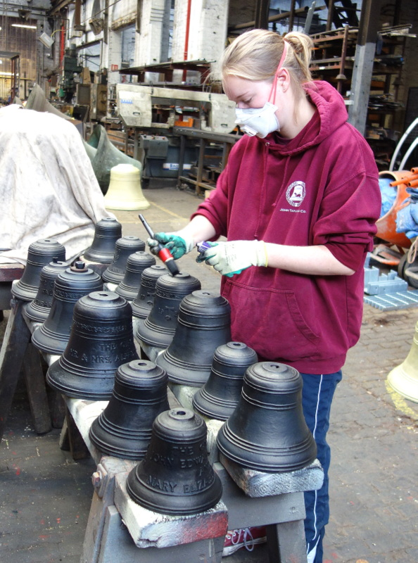 Victoria blacks up the smallest octave of bells after they have been sand blasted