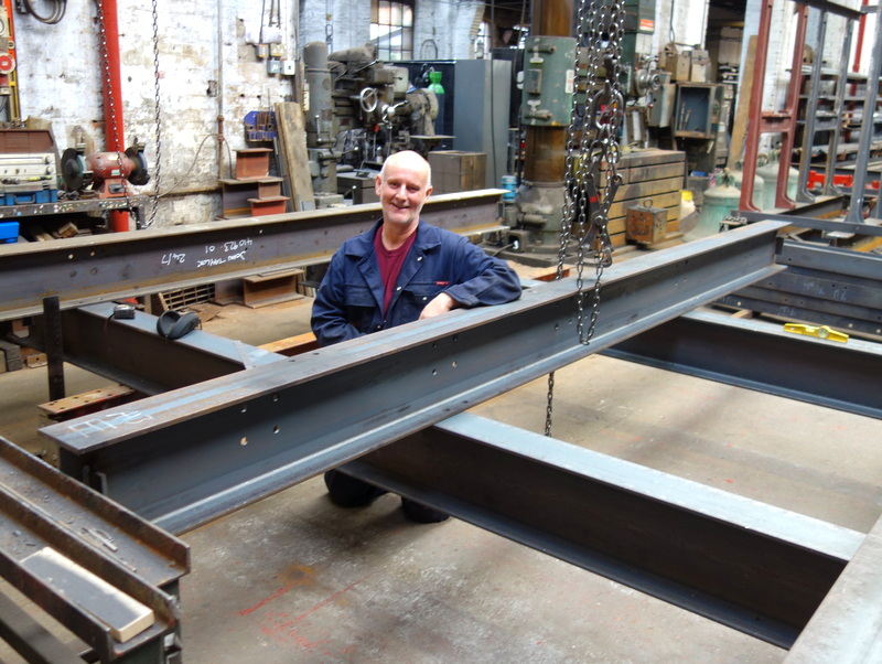 Colin sets out the base girders for the new bell frame.