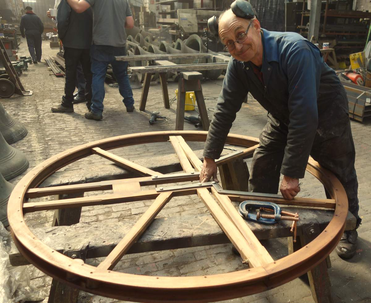 Neil attaches wheel irons to one of the new bell wheels.