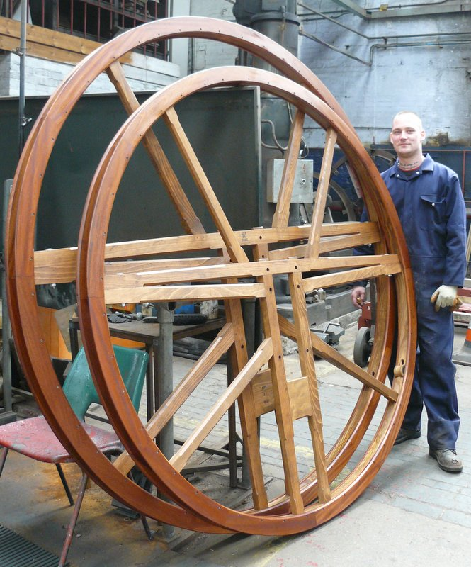 Hardwood bell wheels are constructed in our wood shop.