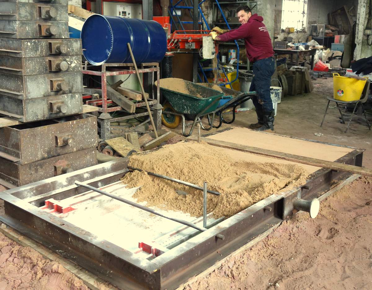 Matt prepares the mould for the casting of a new