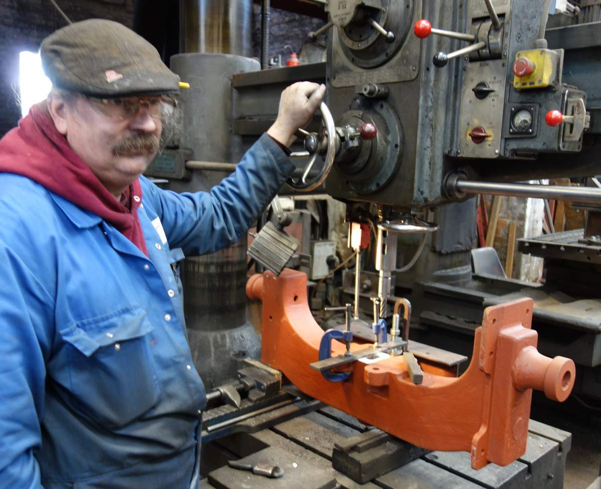 Bill engineers clapper adjusting slots into the old headstocks.