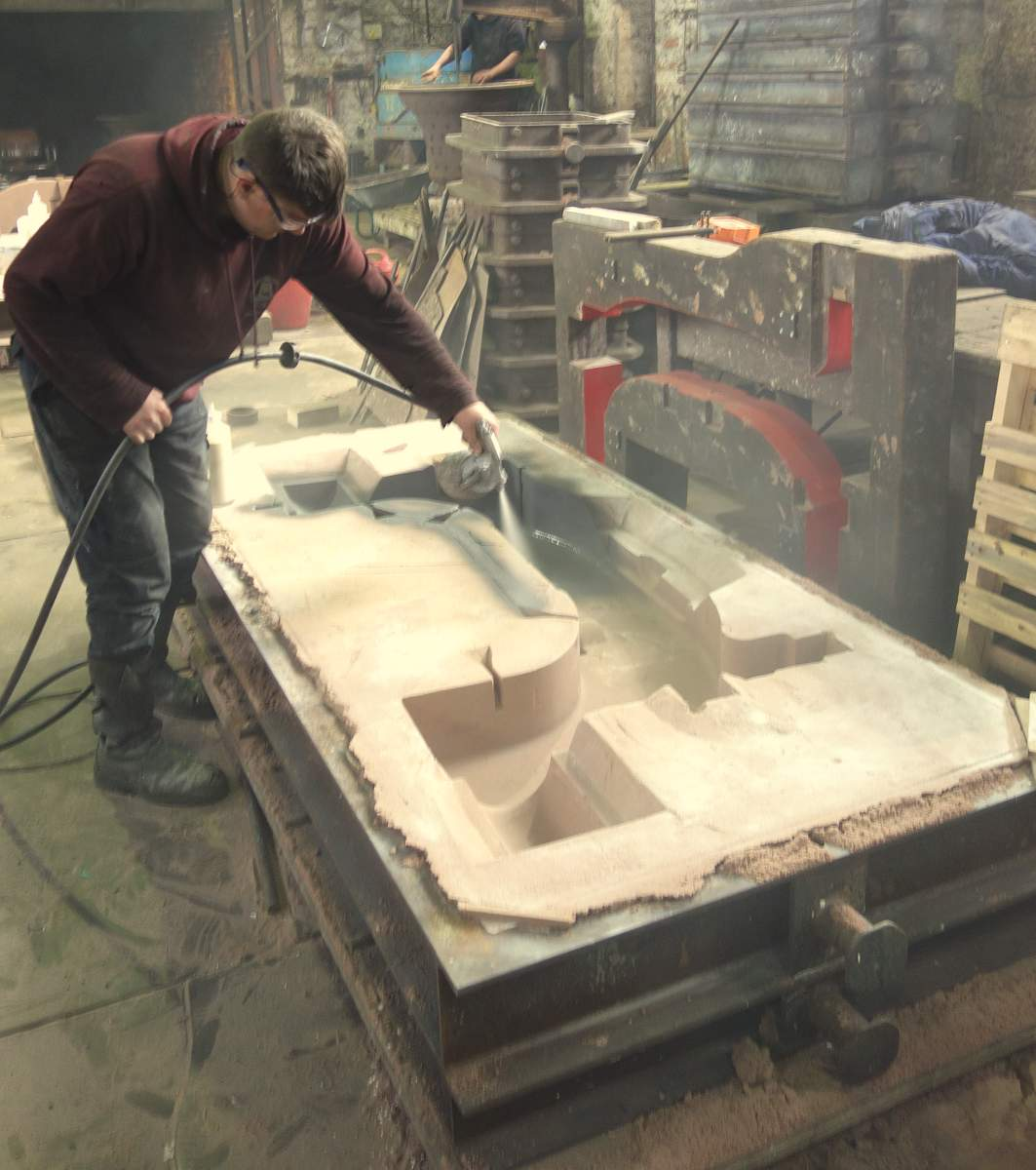 Anthony sprays a parting coat on the inside of the mould.