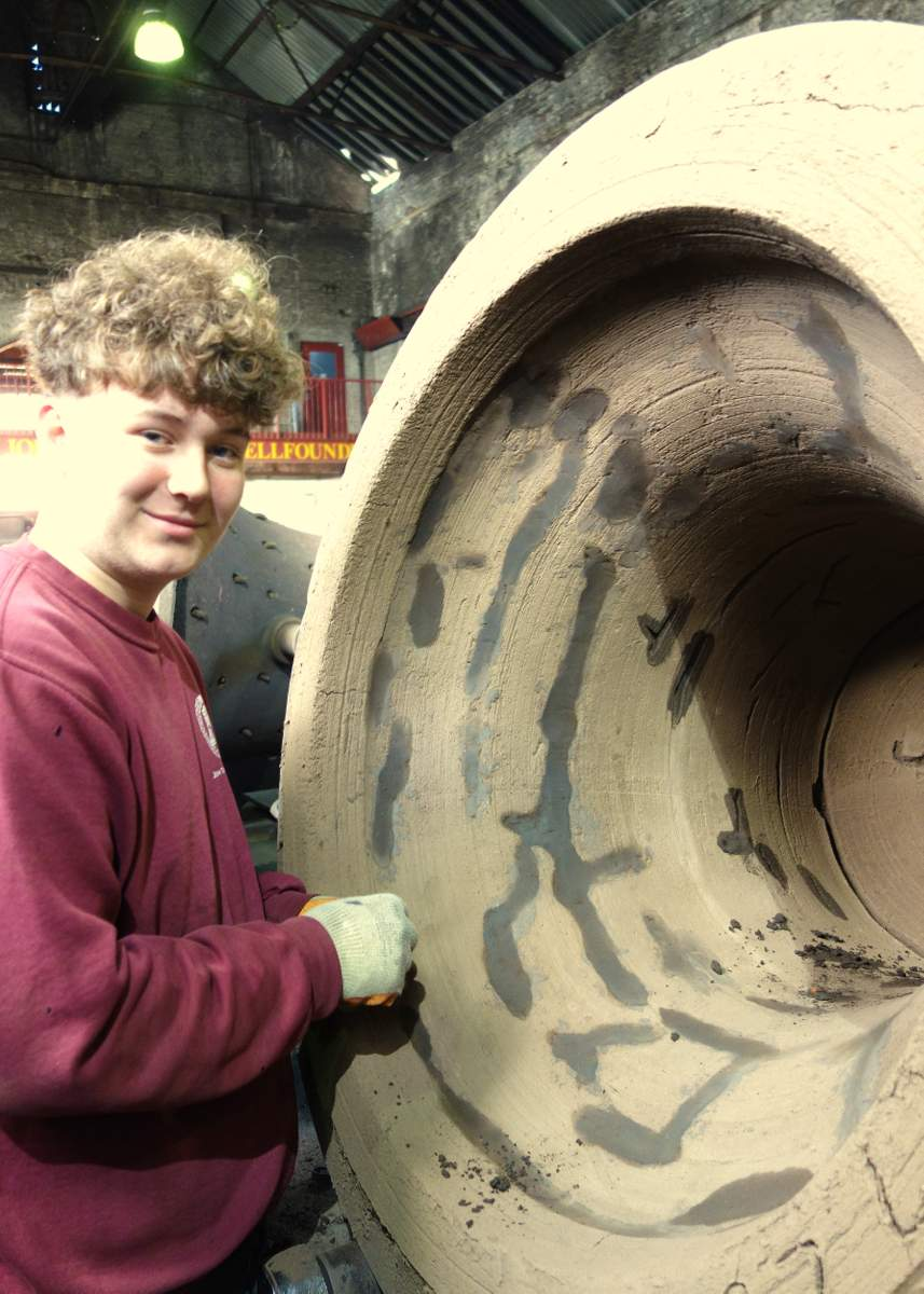 Sam prepares one of the bell moulds!