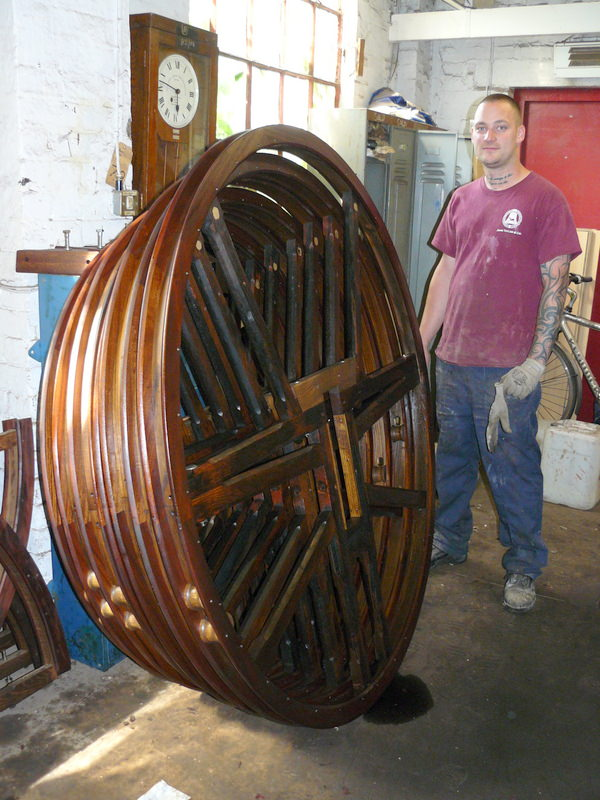 A set of reconditioned bell wheels after treatment with preservative in the Foundry dipping room.