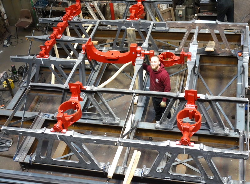 Ross fits sliders and stays in Blockley's new cast iron and steel bell frame as it nears completion.