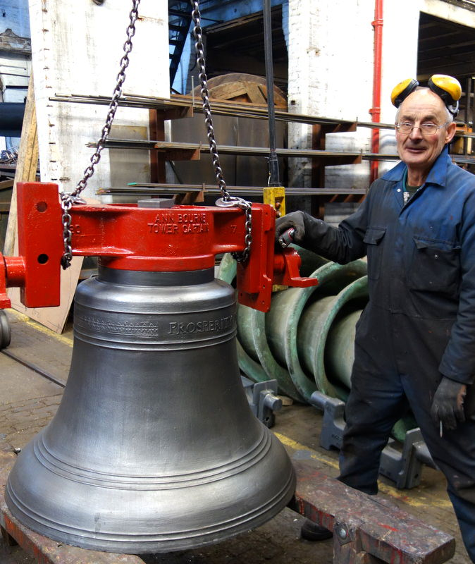 Neil starts fitting the canon retaining headstocks to the bells.