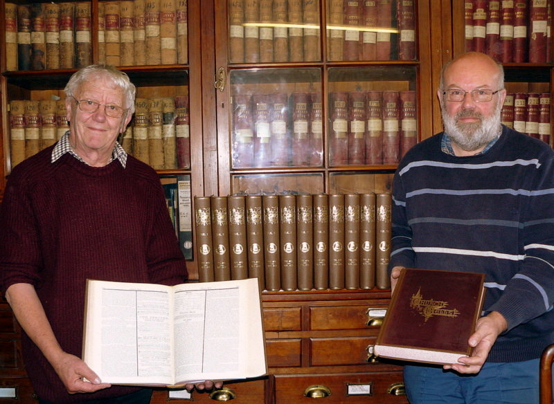 Taylor's Archivists, George Dawson & Chris Pickford, with newly rebound copies of our set of Church Bells - now available digitally on-line.