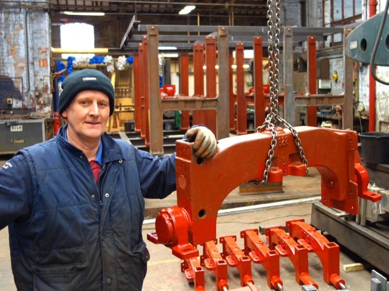 Colin starts to refit the headstocks into the reconstructed bell frame.