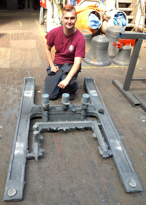 Will begins fettling a newly cast frame side straight from the foundry.