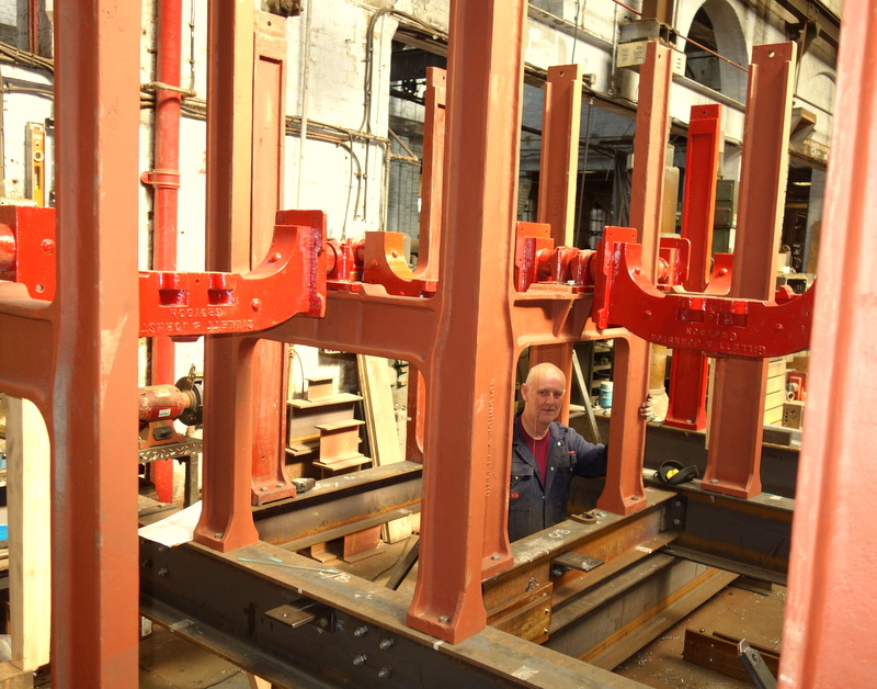 The bells and headstocks are being fitted into the frame before it is dismantled.
