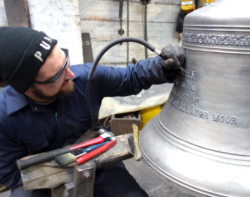 Will begins fettling one of Moresby's new bells.