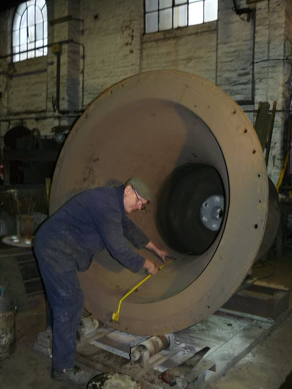 Our foundry master, Roger, prepares the outer mould for a 2 ton bell - this is also called the