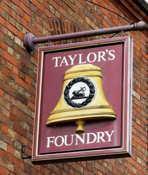 The Taylor's Foundry sign on the outside wall.