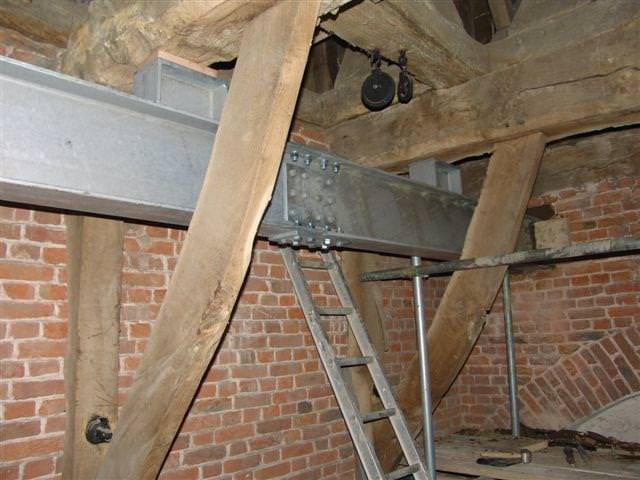 Strengthening an ancient timber bell frame in situ with a new galvanised steel grillage.