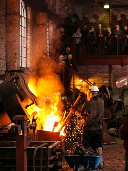 Transferring molten bell metal from one of the furnaces to the crucible prior to casting. Visitors are able to watch from the specially constructed viewing gallery safely well above ground level.