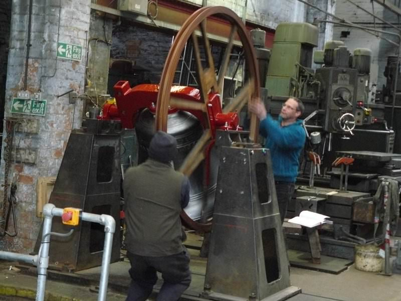 Testing a bell on the ringing-up stand before it leaves the foundry.
