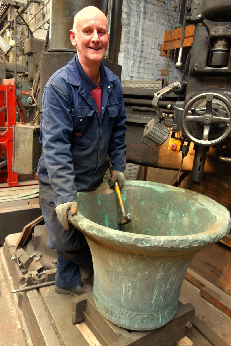 Colin prepares this ancient bell for the removal of its staple.