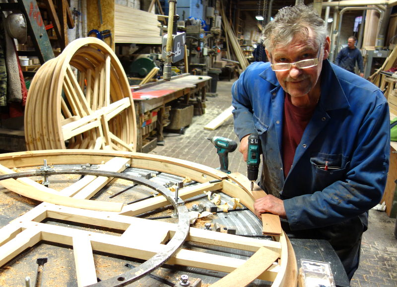 Mick completes the last of Crettingham's new bell wheels - the other five can be seen in the background.