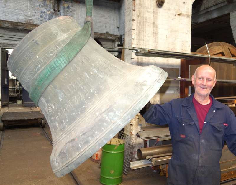 Colin starts work on the bells, drilling out their cast-in iron crown staples
