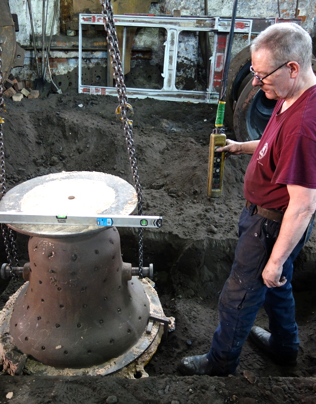 Roger buries one of the new bell moulds prior to casting.