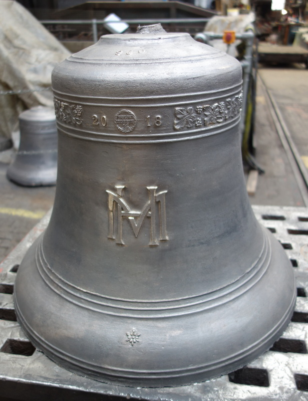 The school logo has been cast onto each of the bells.