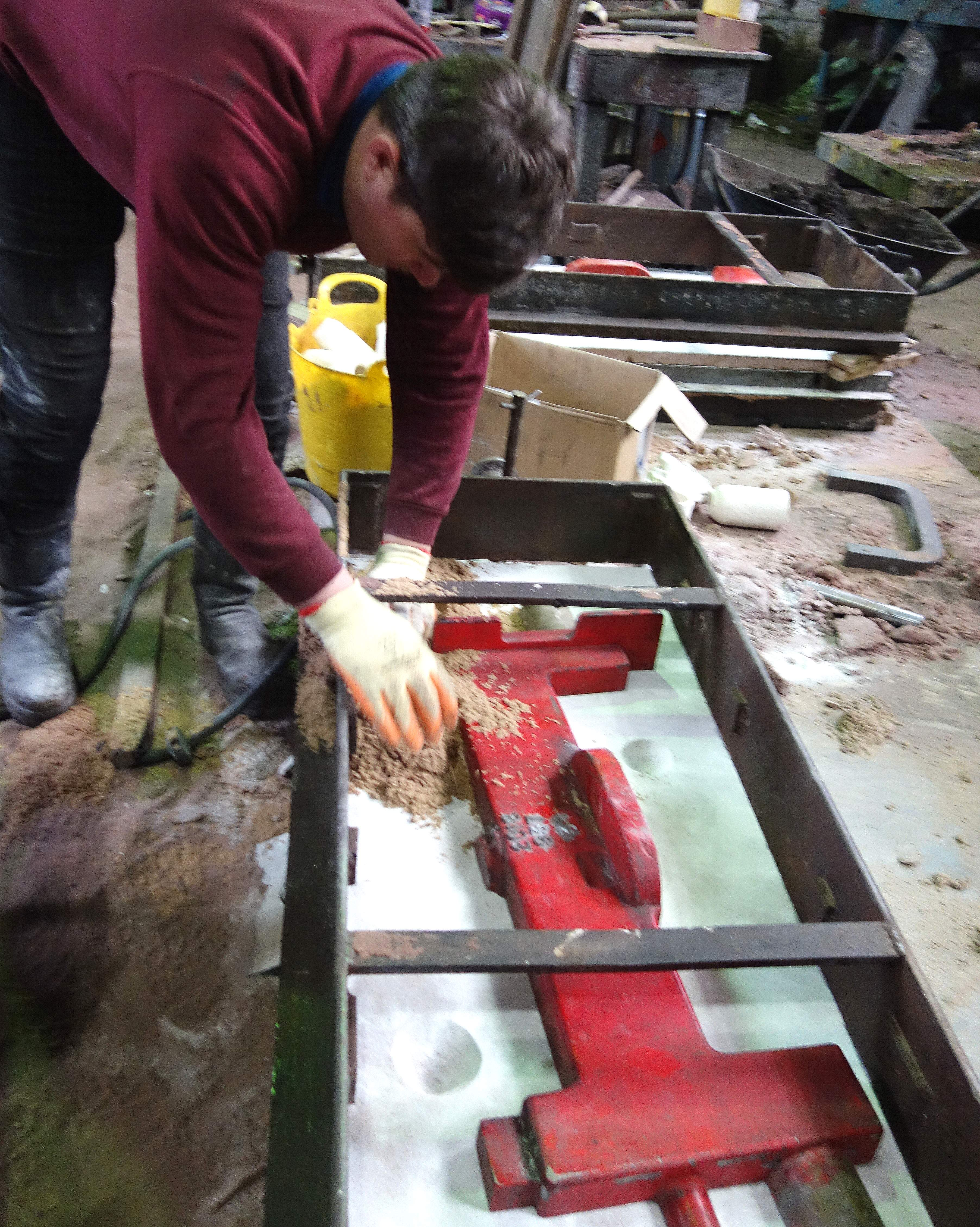 Anthony Stone prepares a new mould for a headstock.