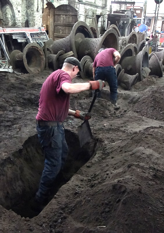 Roger & Matt dig pits to bury the moulds of three of the bells prior to casting.