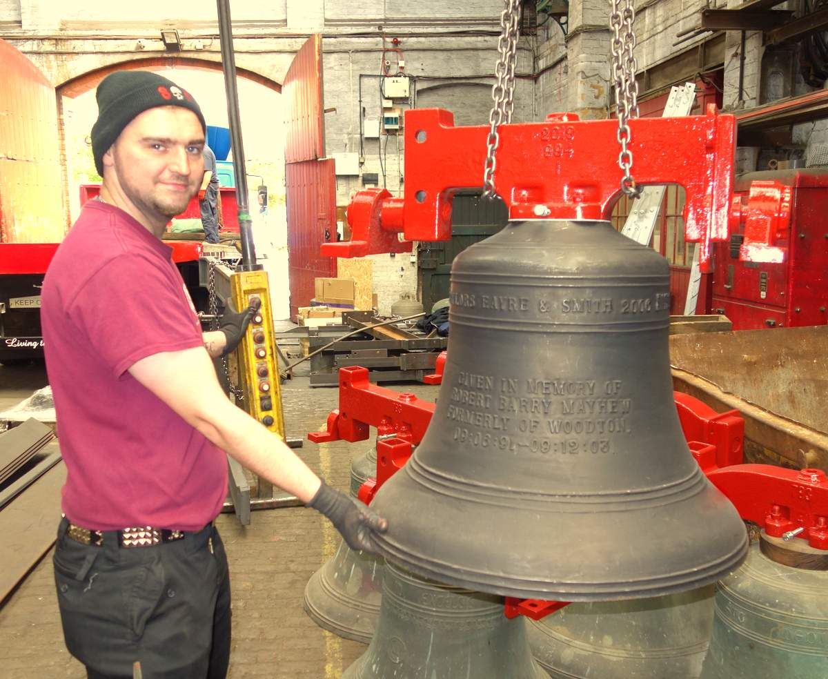 Will loads the bells on to the lorry.