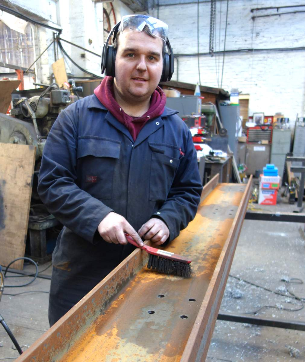 Anthony makes a start on the base girders.