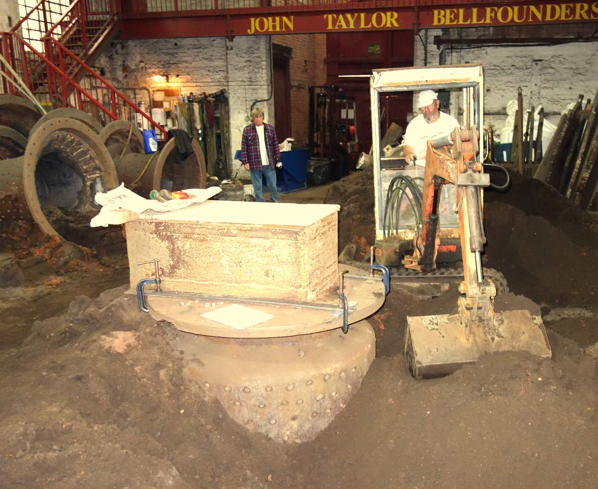 The huge mould is buried ready for casting!