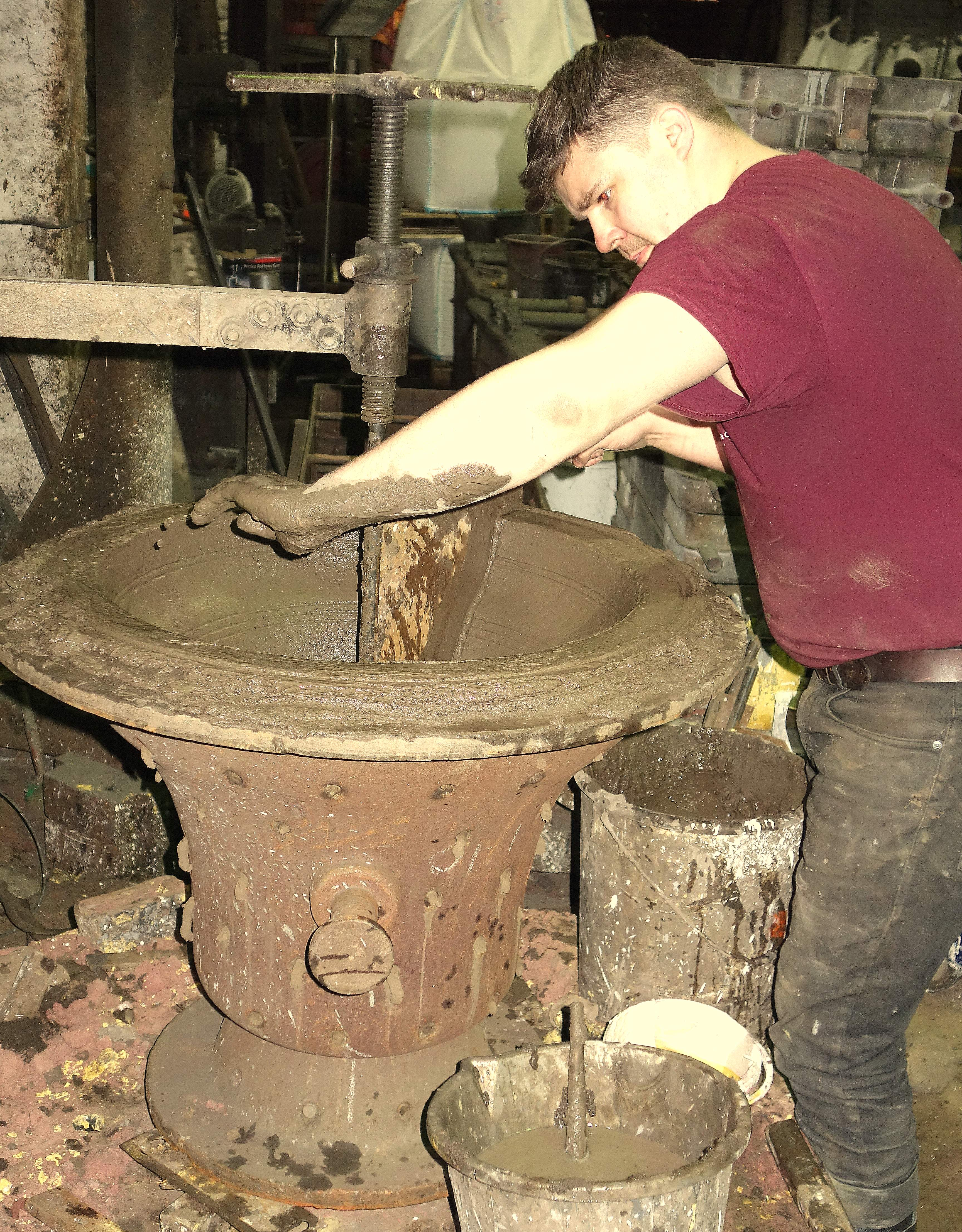 Anthony makes a start on one of the outer moulds - messy work!
