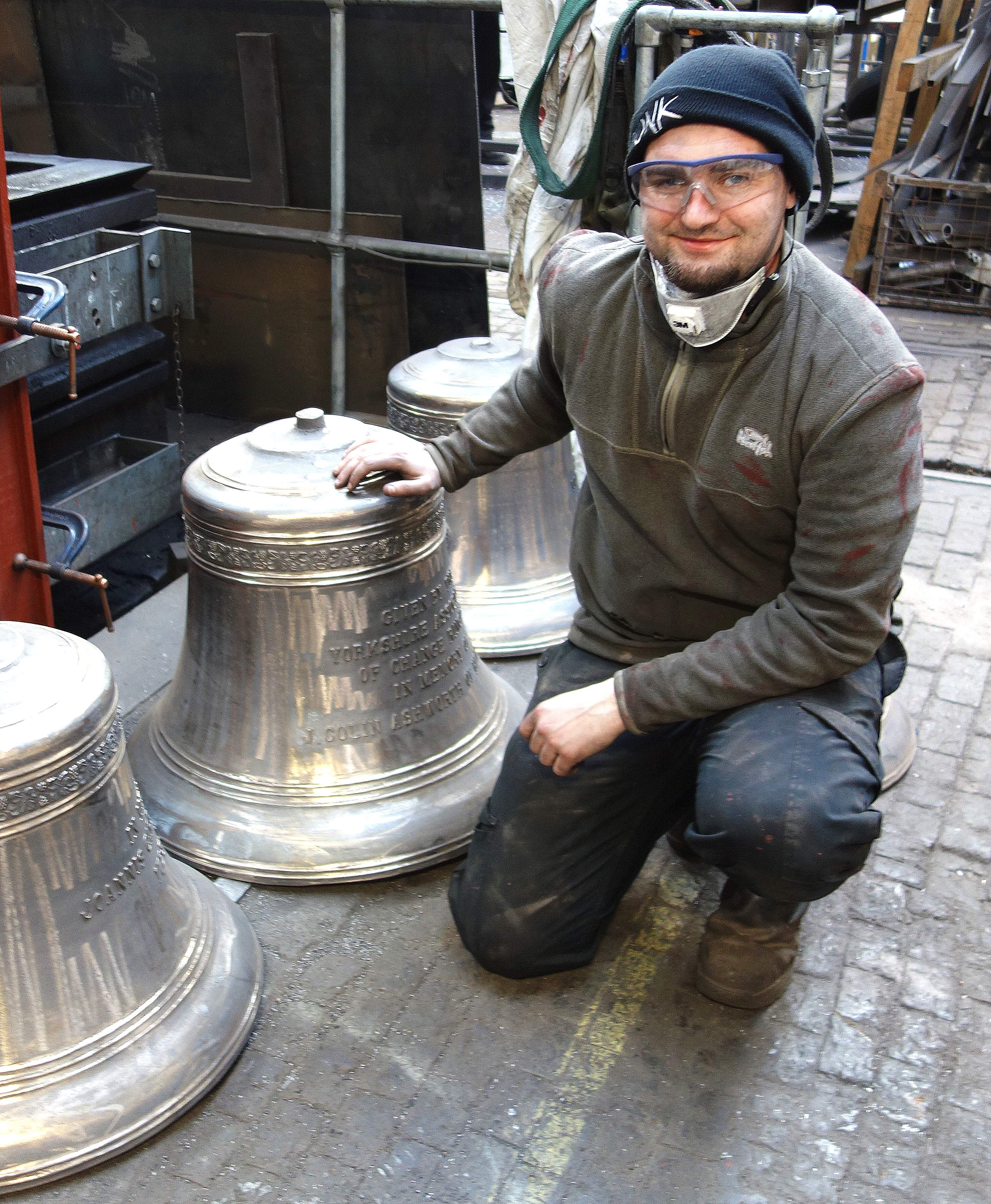 Will fettles the new bells before tuning takes place.