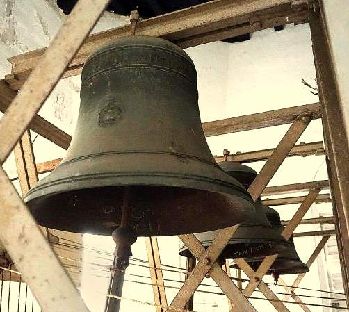 The bells in their original chiming frame in Singapore.