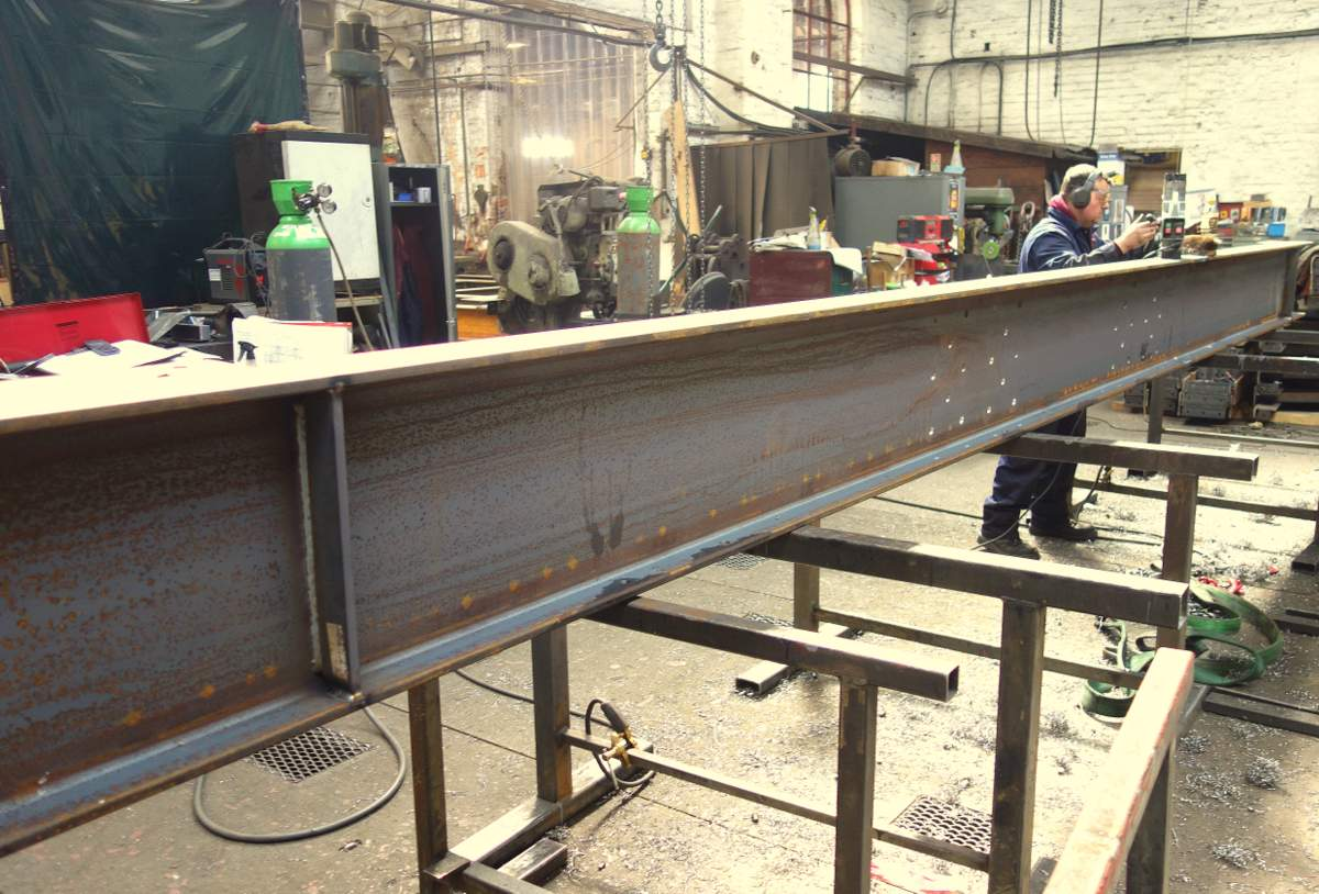 One of the massive base girders being prepared by Anthony.